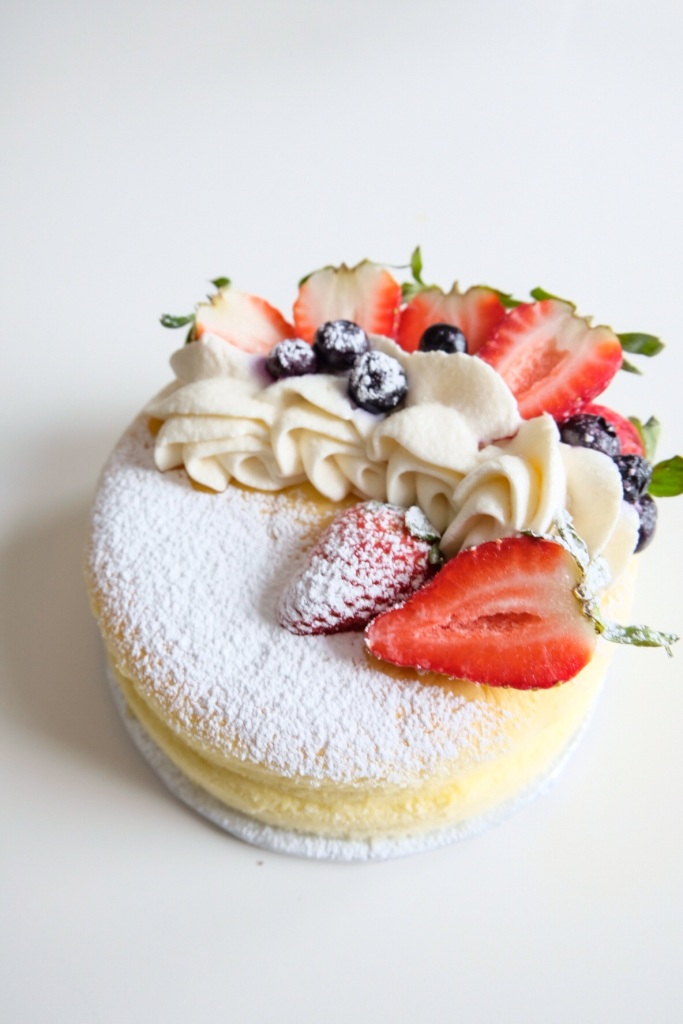 Japanese Cheesecake with whipped cream & berries